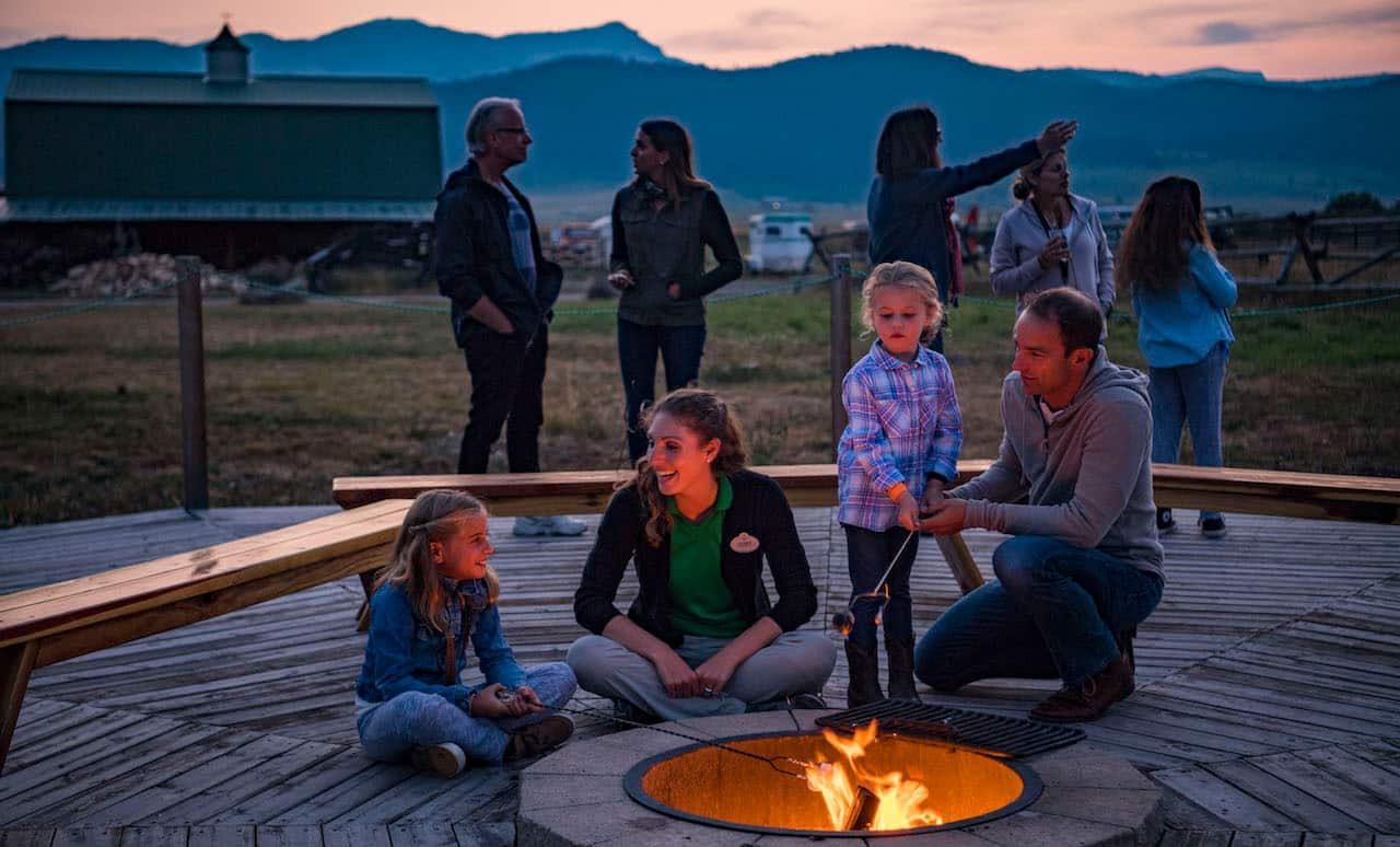 Families roast marshmallows in Montana with Adventures by Disney