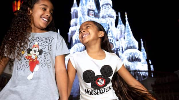 Girls in front of Cinderella Castle during the holidays
