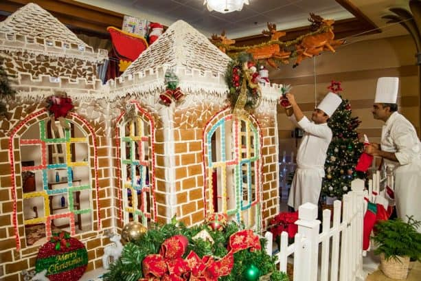 Disney Cruise Line chefs piping icing on the gingerbread house!