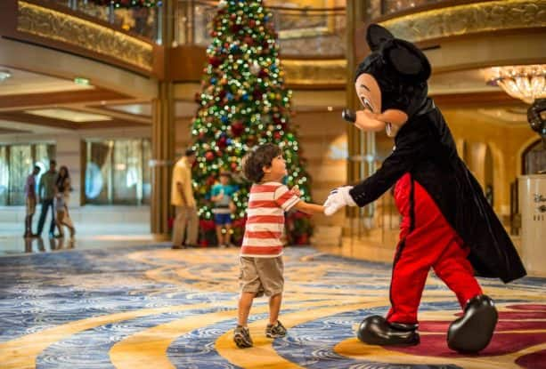 Mickey and child in the atrium onboard Disney Cruise Line