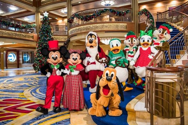 Disney Characters dressed in holiday gear aboard Disney Cruise Line