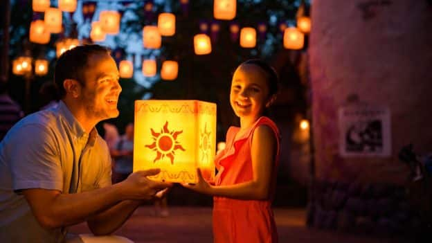 Dad and little girl holding the lantern from Tangled