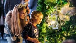 Kids at the Disney Springs Christmas Tree Trail