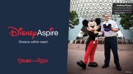 First Disney Aspire graduate, Anthony Payne with Mickey Mouse