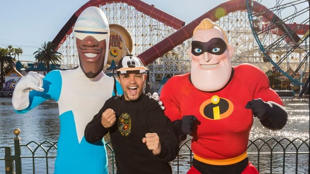 TV Host Trevor Noah Encounters Frozone and Mr. Incredible at Pixar Pier in Disney California Adventure Park