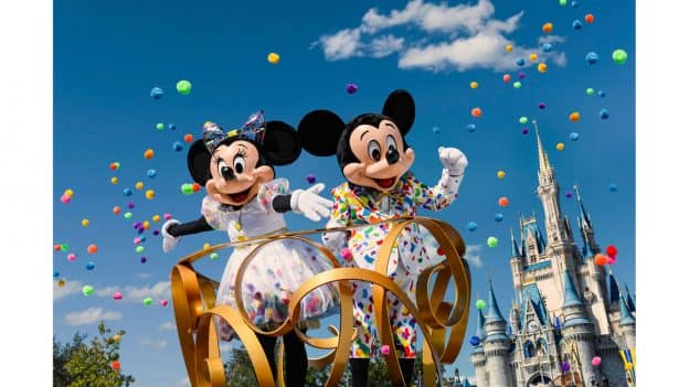 Mickey Mouse and Minnie Mouse in special celebratory outfits – as part of Mickey & Minnie's Surprise Celebration at Magic Kingdom Park