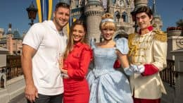 Tim Tebow and fiancé Demi-Leigh Nel-Peters celebrate their engagement at Magic Kingdom Park with Cinderella and Prince Charming