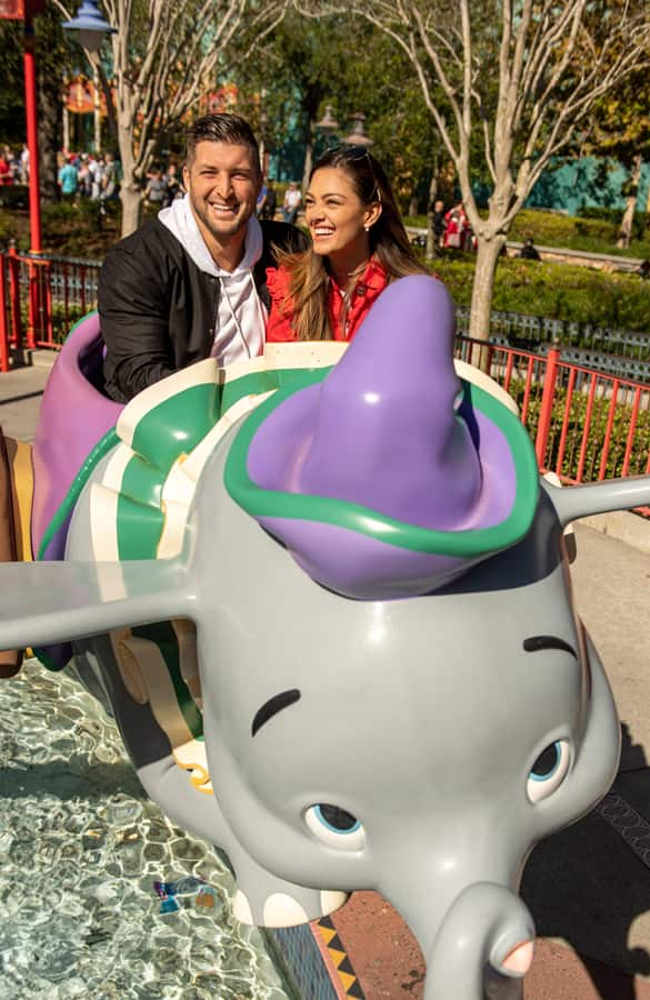 Tim Tebow and fiancé Demi-Leigh Nel-Peters ride Dumbo the Flying Elephant at Magic Kingdom Park