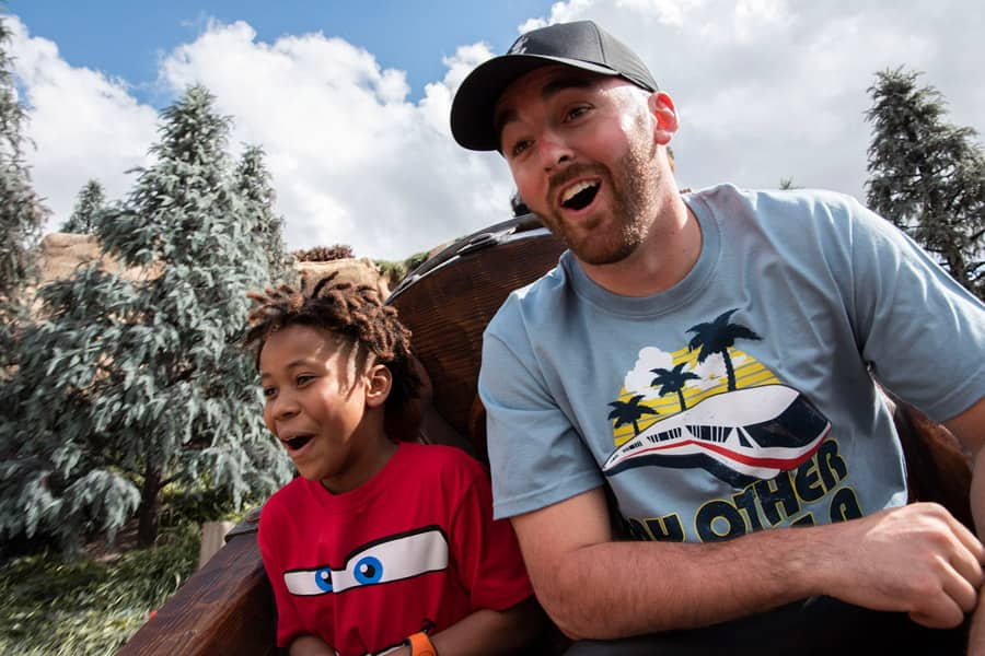 Defending Daytona 500 Champion Austin Dillon and young fan Jordan Wade ride Seven Dwarfs Mine Train at Magic Kingdom Park