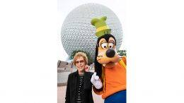 Carol Burnett and Goofy post at Epcot at Walt Disney World
