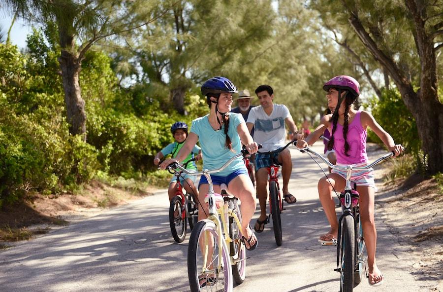 Family riding bikes on Disney's Castaway Cay