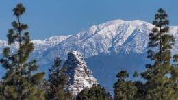 Disneyland's Matterhorn against snowcapped San Gabriel Mountains