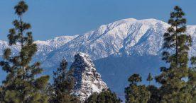 Disneyland's Matterhorn against snowcapped San Gabriel Mountains