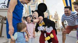 Family with Mickey Mouse at Magic Kingdom Park