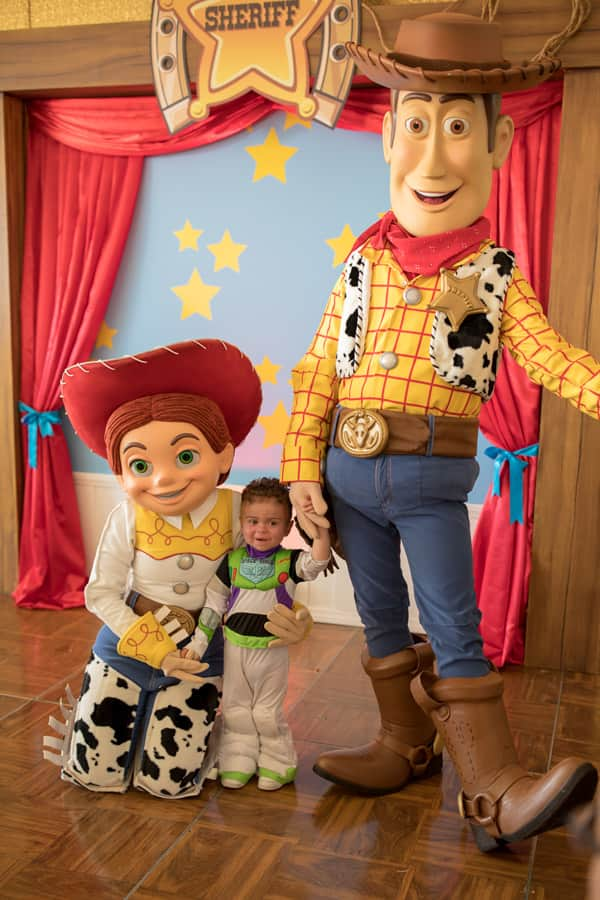 Jessie and Woody pose for a photo with a child during ToyFest at City of Hope