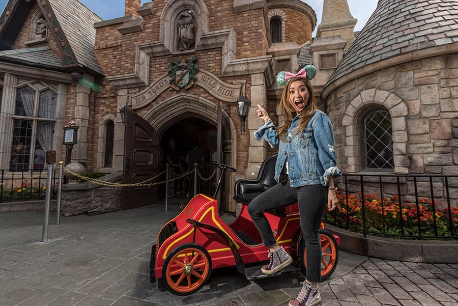 Brenda Song visiting Disneyland park, at Mr. Toad's Wild Ride