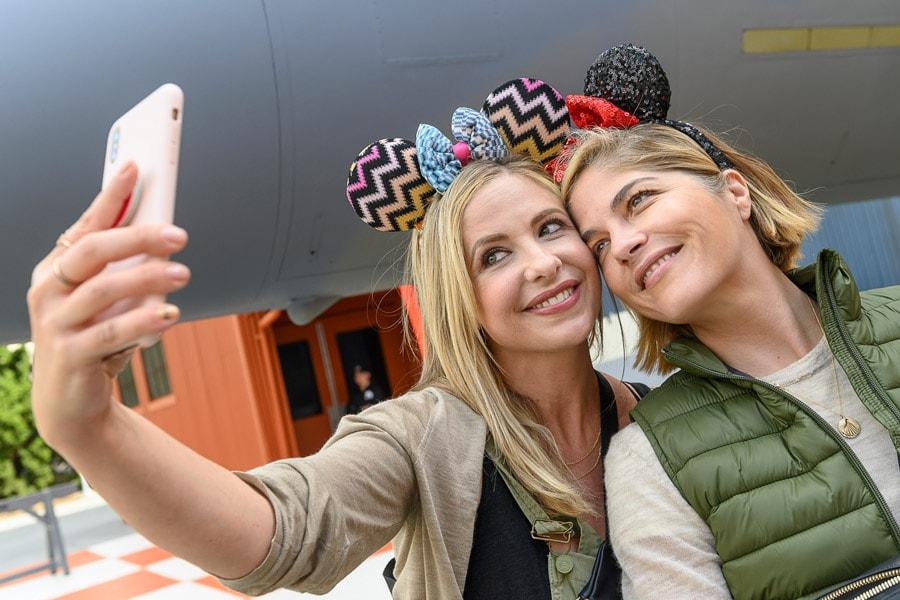 Sarah Michelle Gellar and Selma Blair pose for a selfie at Disney California Adventure park