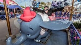Director Tim Burton rides Dumbo at Disneyland Park