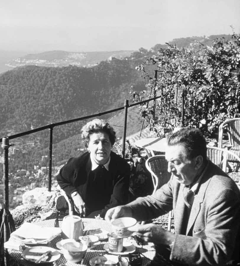 Walt and Lillian Disney dining with a view of beautiful vistas, cliffs, islands and the Mediterranean Sea  - Photo courtesy of Walt Disney Archives