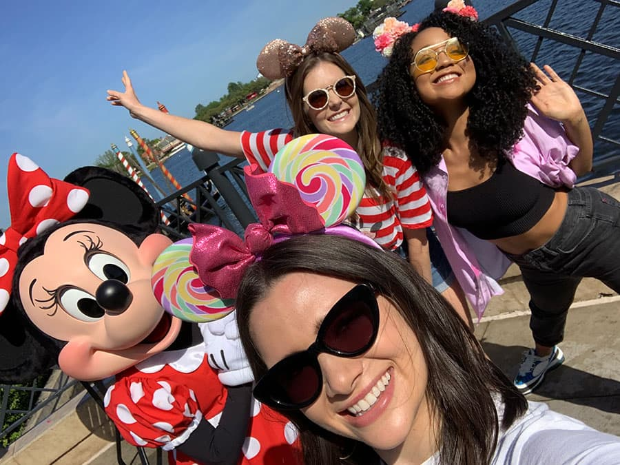 Katie, Aisha, and Meghann taking selfies with Minnie Mouse