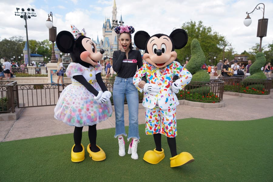 Actress Sofia Carson poses with Mickey Mouse and Minnie Mouse at Magic Kingdom Park