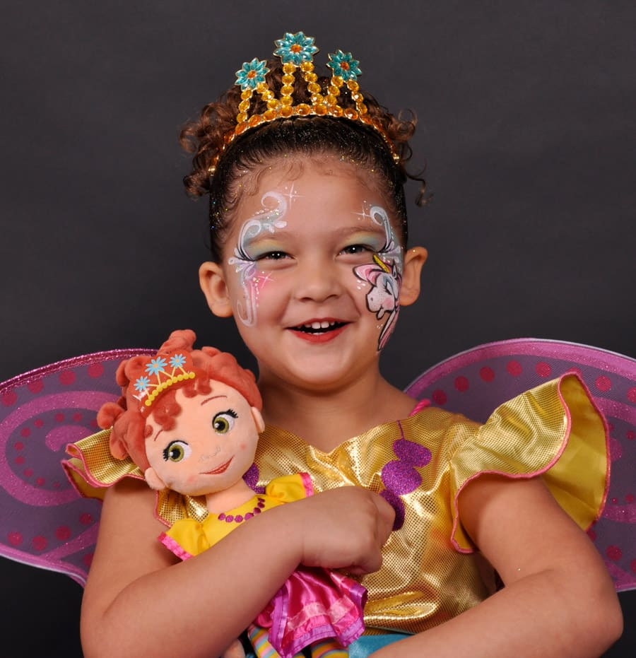Young guest with Fancy Nancy costume, Fancy Nancy doll and face painting from 'In Character' at Disney's Hollywood Studios