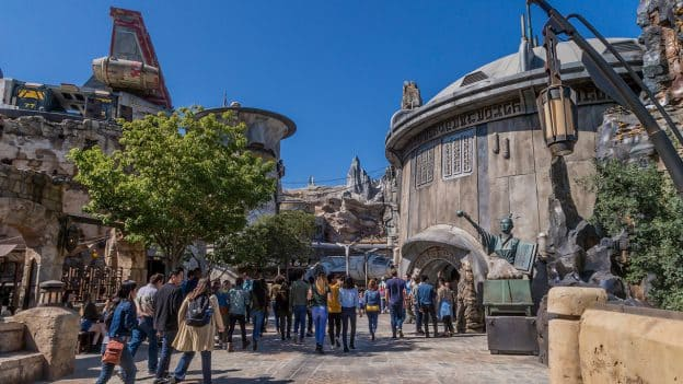Guest visiting Star Wars: Galaxy's Edge at Disneyland Park