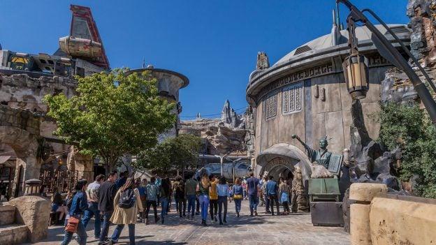 Guest visiting Star Wars: Galaxy's Edge at Disneyland Park