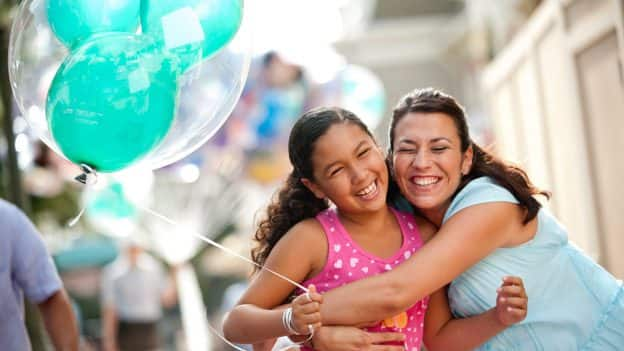 Mom and Daughter share a hug at Disney Parks