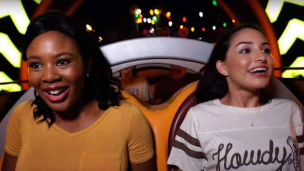 Two friends riding Slink Dog Dash in Toy Story Land