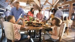Family enjoying Chef Art Smith's Homecomin' at Disney Springs