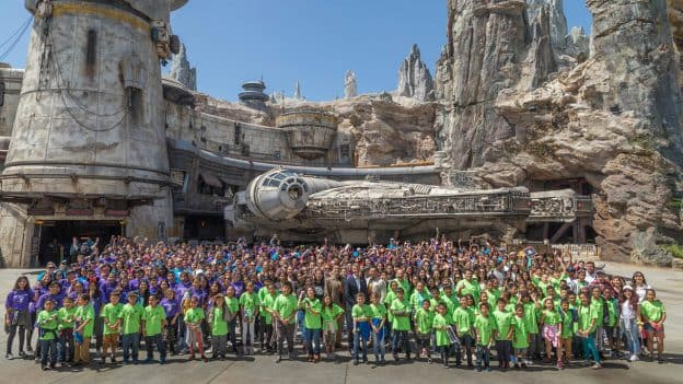 More than 600 children from Anaheim community organizations pose for photo in Star Wars: Galaxy's Edge at Disneyland park