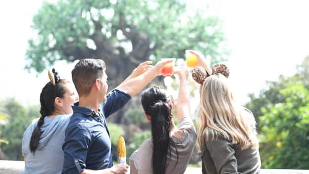 Friends raise glasses at Disney's Animal Kingdom