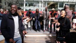 """Singers featured in Disneyland Paris' new original show, """"The Lion King: Rhythms of the Pride Lands"""" surprise travelers with a performance at the Gare de Lyon train station in Paris"""