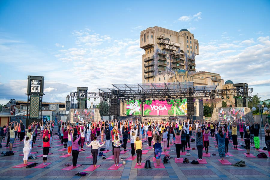 Cast members at Disneyland Paris collected at Walt Disney Studios park for a peaceful yoga session at Production Courtyard in front of Tower of Terror