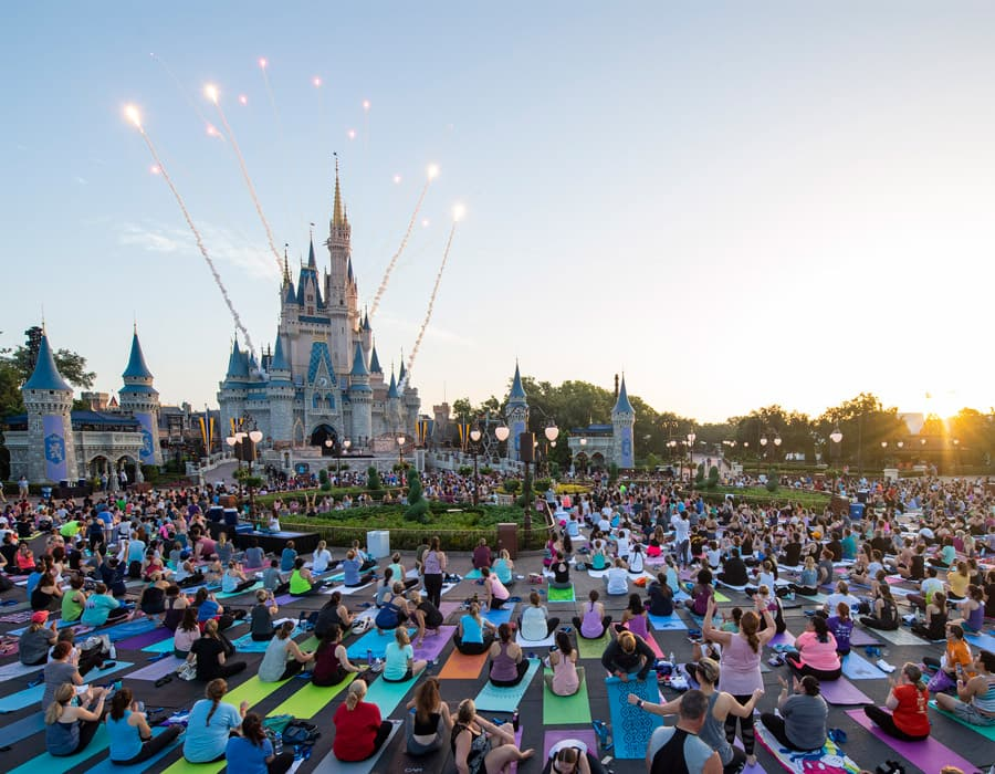 More than 1,650 yoga mats were rolled out in front of Cinderella Castle for an exciting yoga session for cast members at Magic Kingdom park, complete with fireworks