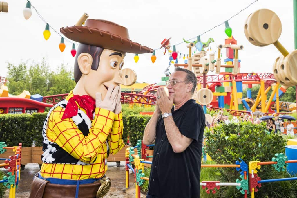 Tom Hanks (left) with Woody (right) inside Toy Story Land at Disney's Hollywood Studios