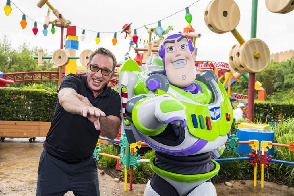 Tim Allen (left) with Buzz Lightyear (right) inside Toy Story Land at Disney's Hollywood Studios