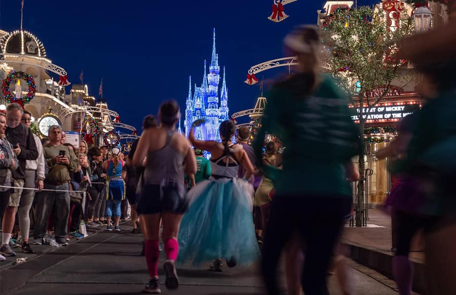 Runner and Cinderella Castle at Walt Disney World Marathon Weekend