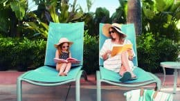 Mom and Daughter sitting in pool chairs