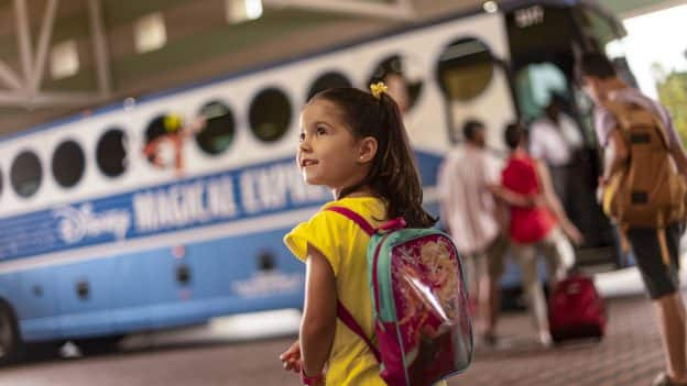 Girl waiting to board Disney's Magical Express