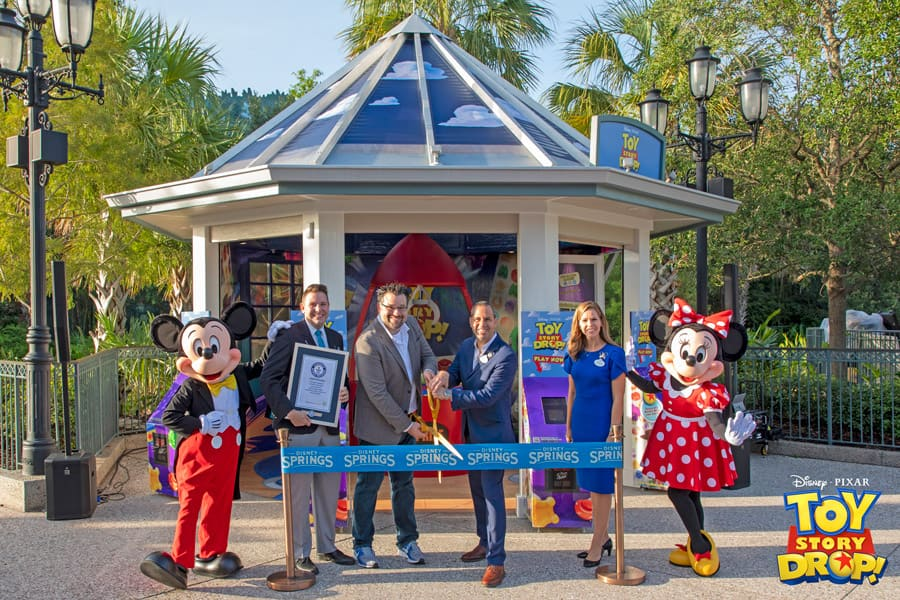 Ribbon cutting at the Toy Story Drop! pop-up experience at Disney Springs