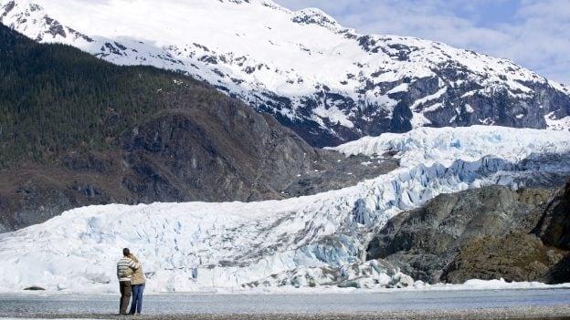 Couple looking at glacier in Alaska