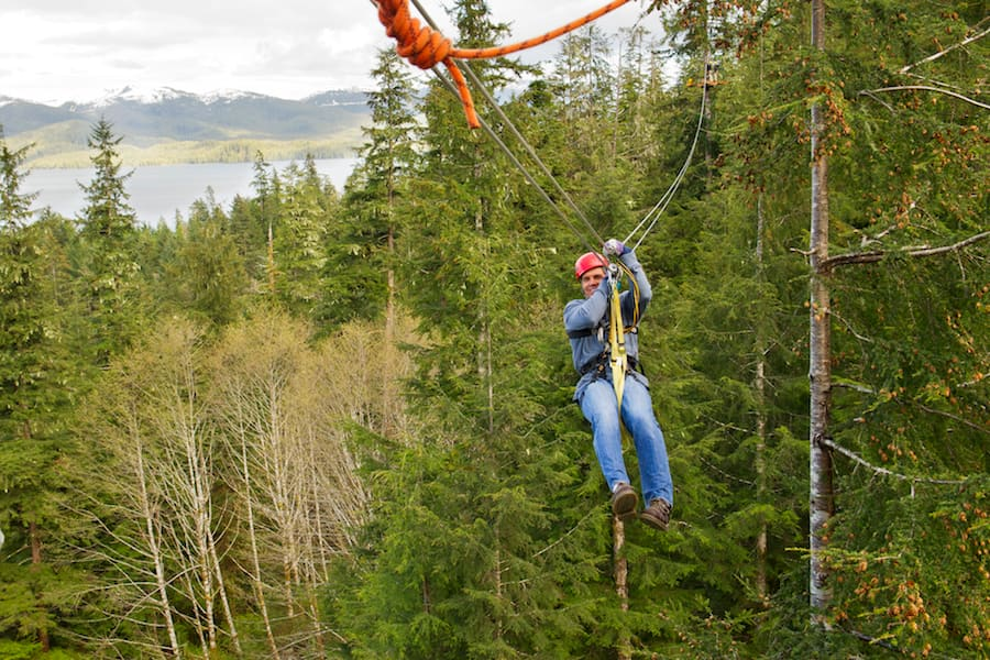 Man zip-lining in Alaska