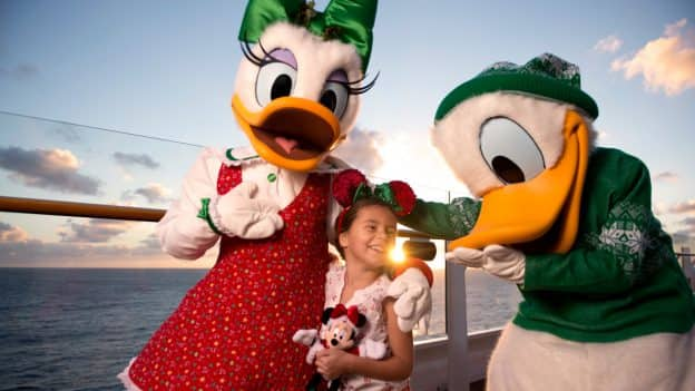 Daisy, little girl and Donald at a Disney Cruise