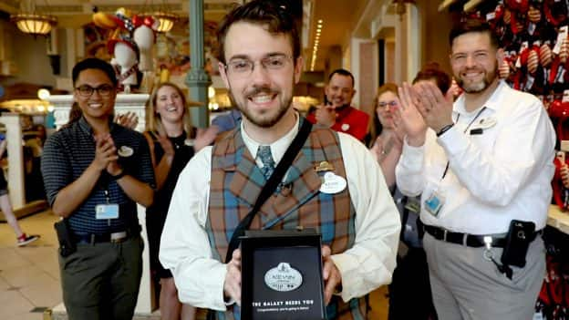 Walt Disney World cast member Kevin smiles with Star Wars: Galaxy's Edge name tag