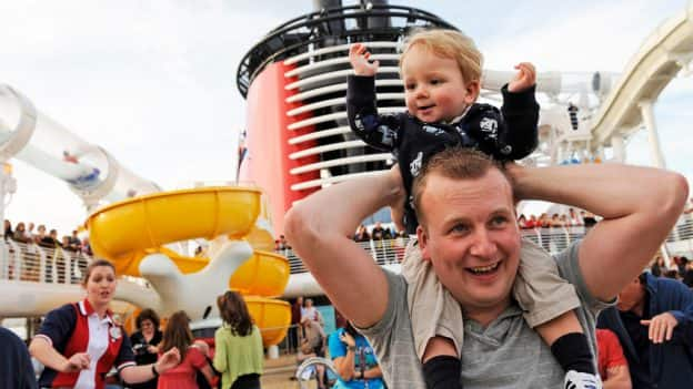Dad and son aboard a Disney Cruise