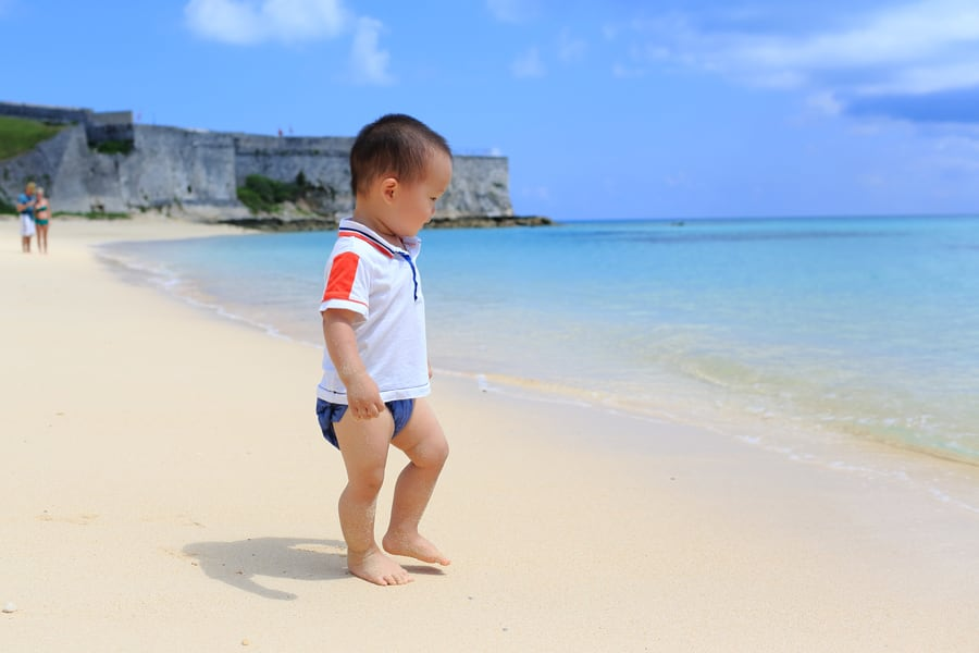 Toddler plays on beach