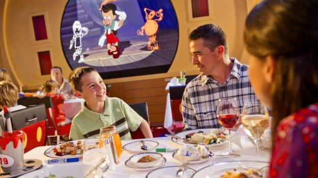 Family have dinner on a Disney cruise