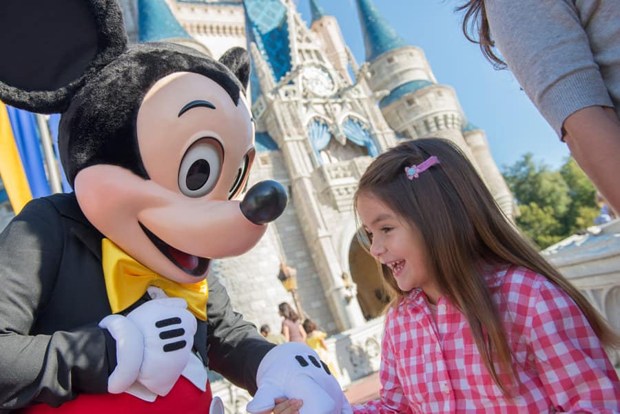 Mickey and little girl in front of Castle